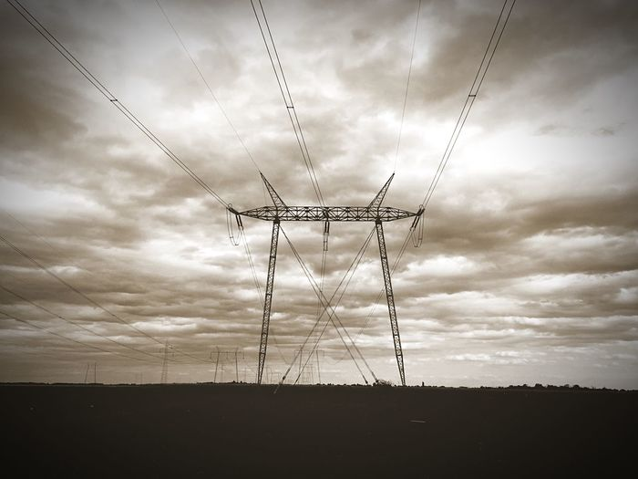 Landscape Fuel And Power Generation Sky Low Angle View Silhouette Cloud Electricity Pylon Power Line  Cloud - Sky Field Cloudy Power Supply Day Outdoors Nature Countryside Tranquility No People Tranquil Scene Tall