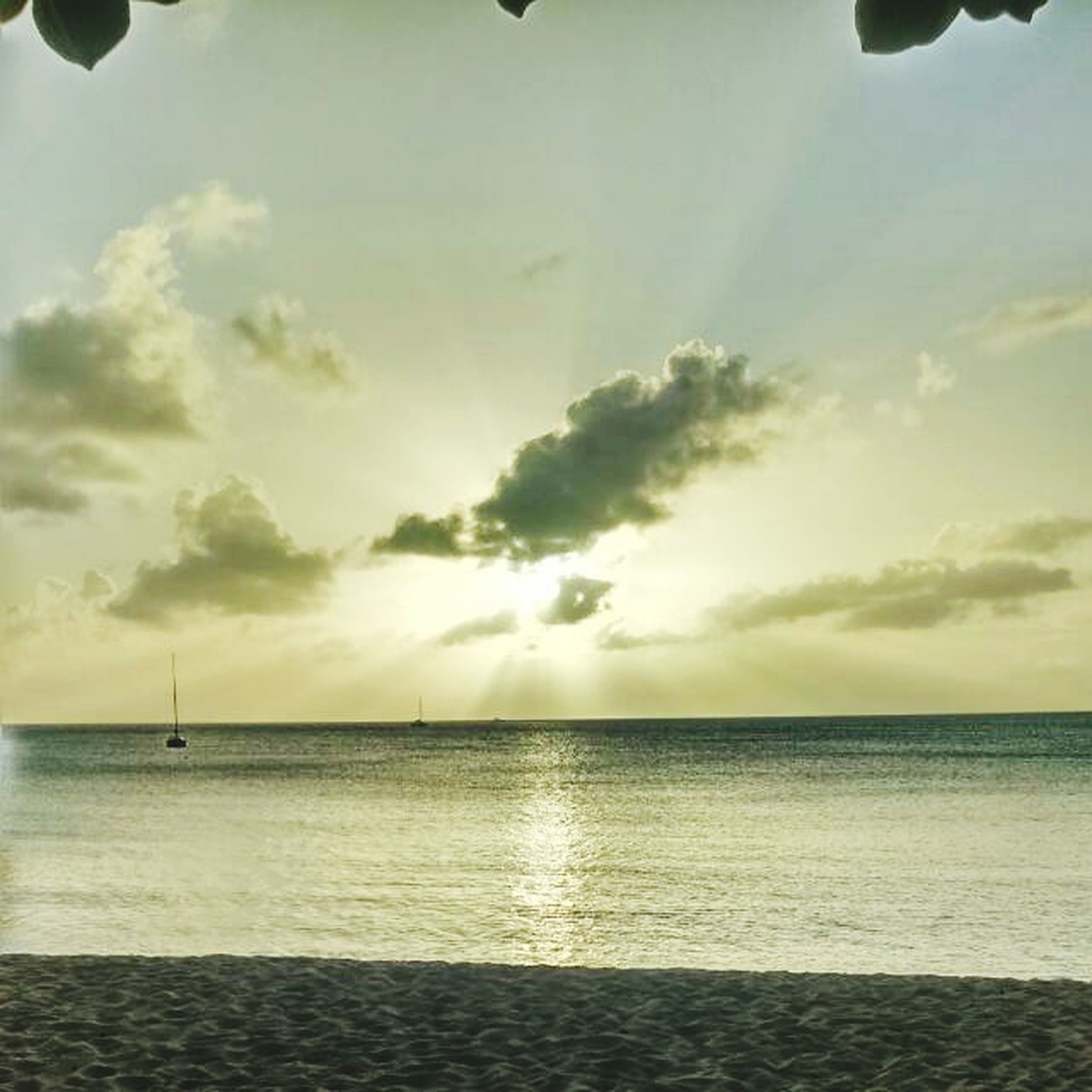 sea, horizon over water, water, sky, scenics, tranquil scene, tranquility, beauty in nature, beach, sunset, cloud - sky, nature, idyllic, shore, sun, nautical vessel, cloud, transportation, sunlight, seascape