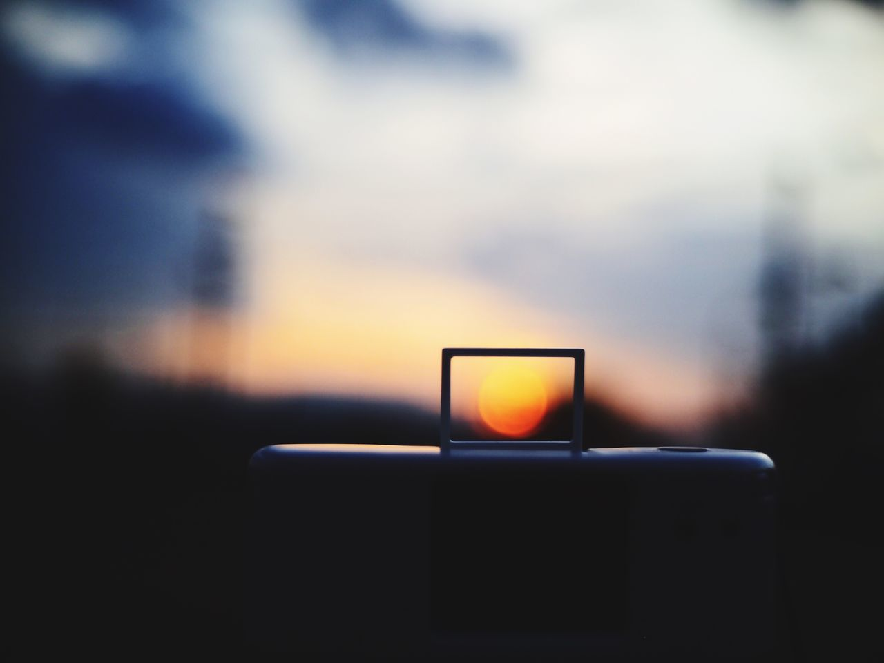 Sunset Seen Through Digital Tablet Handle