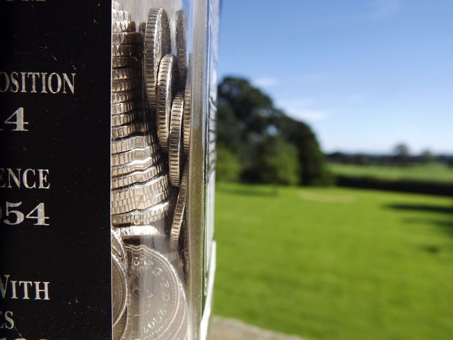 Coins In A Bottle Coins Coins Collection Coins In Bottle Wiskey Bottle Garden Grass Trees And Sky Sky Trees Summer Summertime Macro Macro Photography Blue Sky Still Life Eye Em Sunny Day Calm From My Point Of View Landscape Landscapes Piggybank
