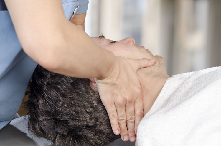 Physiotherapist, chiropractor is doing manipulation cervical to a man patient. Osteopathy Back Doctor  Man Medicine Pain Therapy Woman Cervical Chiropractor Clinic Healthcare And Medicine Injury Manipulation Massage Medical Muscles Muscular Patient person Physiotherapy Professional Stretching Therapist