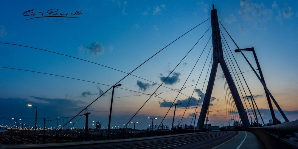 View of bridge against sky at sunset