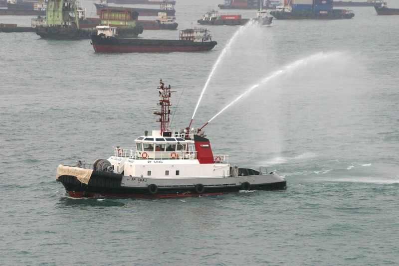 Hong Kong Harbour - A fire boat gives the traditional welcome to the QE2 cruiseship Day Drilling Rig Fire Boat Freight Transportation Hong Kong Harbour Motion Nature Nautical Vessel No People Offshore Platform Oil Pump Outdoors QE2 Sailing Scrapped Vessels Sea Shipping  Sky Spraying Transportation Water Waterfront