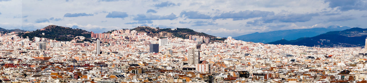Panoramic shot of townscape against sky, barcelona, spain