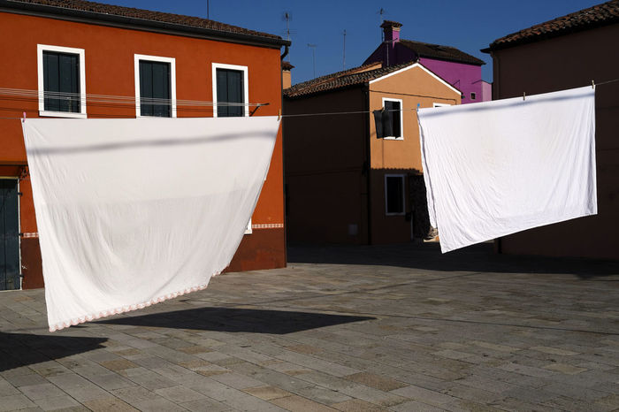 Shadow Architecture Blanket Building Exterior Built Structure Burano Burano Island Burano, Italy Day Door High Noon House Household Isa Island Italy No People Noodles Out To Dry Outdoors Painted Wall Residential Building Towel Travel Destination Village Life