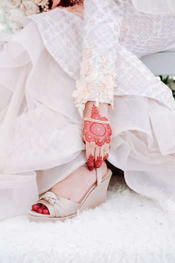 Beautiful henna drawing on wedding day in Malaysia Women Bride Newlywed Real People Adult Event Celebration White Color Human Body Part Wedding Wedding Dress Lifestyles Low Section One Person Body Part Life Events Human Leg Clothing Love Fashion Positive Emotion Beautiful Woman Wedding Ceremony