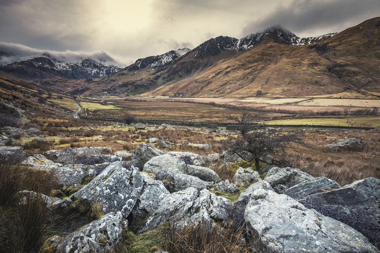 Snowdonia Mountains at early Spring Sunlight Travel Tree United Kingdom Wales Adventure Backgrounds Beauty In Nature Day Dramatic Landscape Mountain Mountain Range Nature No People Outdoors Range Rocks Scenery Scenics Sky Snow Stones Tranquil Scene Travel Destinations