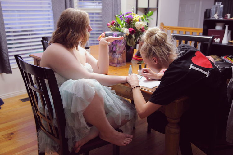 Our daughter getting ready for her first homecoming dance. She was very excited. She has a hard time fitting in with other children her age. She has narcolepsy, hypothyroidism, scoliosis, mild cerebral palsy and a severe learning disability. America Autism Beauty Bonding Disabled Family Girl Homecoming Learning Life Lifestyles Love Love Moments Person Real People Sisters Sitting Teen Togetherness Utah Young Adult