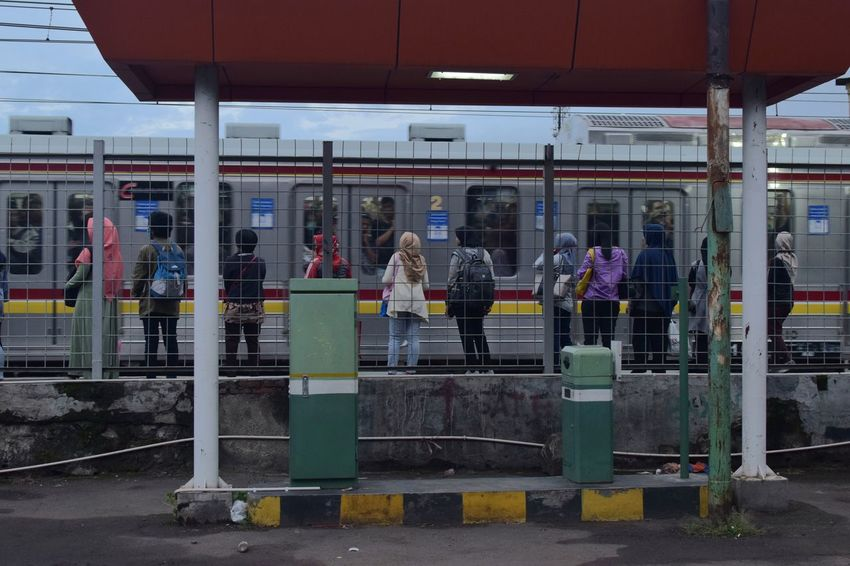 Bintaro, January 2018 Streetphotography Documentaryphotography Train Train Station Commuting Commuter Commute UNPOSED Candid Train - Vehicle Adult Outdoors People Day Adults Only Only Men