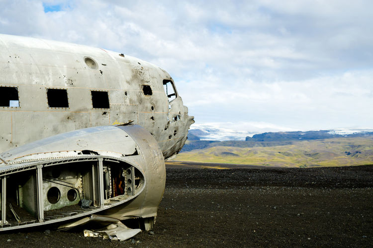 Air Vehicle Airplane Close-up Cloud Cloud - Sky Cloudscape Damaged Day DC-3 Field Iceland Journey Land Vehicle Landscape Mode Of Transport No People Outdoors Part Of Plane Sky Stationary Transportation Vibrant Color Weathered Ww2