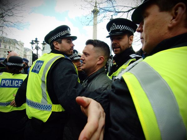 Tommy Robinson. Founder of the English Defence League, goading anti Facism protesters and being escorted away by Metropolitan police officers. London. 01-04-2017 Tommy Robinson Police Force Olympus Protesters Protest EDL Metropolitan Police English Defence League Uk London Stevesevilempire Steve Merrick London News Zuiko Police Policing Racist Racism Right Wing
