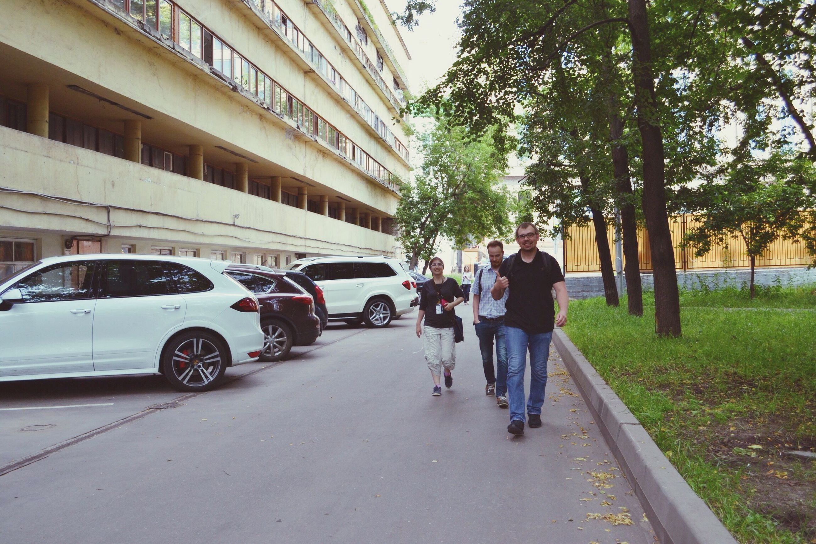 car, full length, togetherness, walking, road, transportation, tree, architecture, outdoors, real people, men, city, day, friendship, sky, people