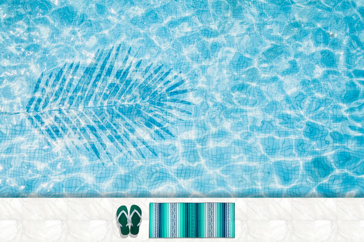 Pool float, ring floating in a refreshing blue swimming pool Backgrounds Blue Clean Day Directly Above Floating On Water High Angle View Nature No People Pattern Pool Poolside Rippled Summer Sunlight Swimming Pool Tile Transparent Trip Turquoise Colored Vacations Water