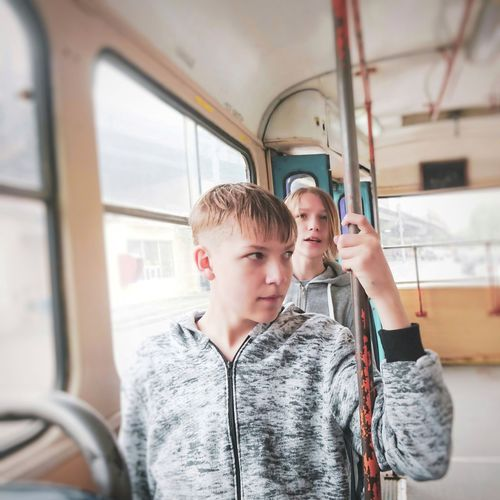 Portrait of friends in train