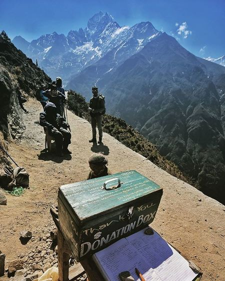 This smooth pathway made by hand mr. Pasang Sherpa (seated) and his colleagues with donation help by hikers. Now the amazing view of Amadablam can be seen without hustle Nepal Himalaya Dktm MyGHT Meistershots Theglobewanderer CreateExplore Illgrammers Moodygrams Urbanandstreet Symmetricalmonsters Artofvisuals AOV Createcommune Agameoftones Wayzill Igshotz_mag Soft_vision Igshotz_folk ExploringGlobe Alldayexploring Travel2next 30xthirty Zerogrid Myfeatureshoot worlderlust worldtravelpics modernoutdoorsman exploretocreate