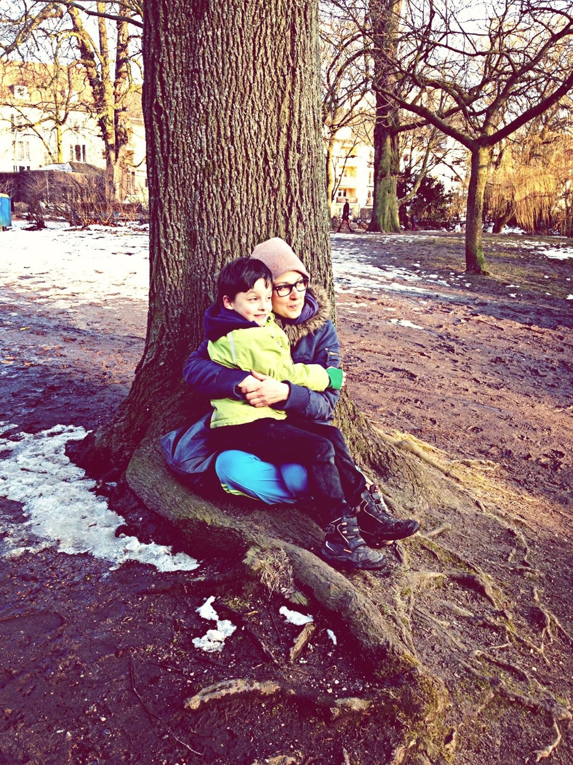 tree, childhood, park - man made space, tree trunk, creativity, elementary age, art and craft, lifestyles, art, leisure activity, full length, boys, day, park, person, outdoors, animal representation, human representation