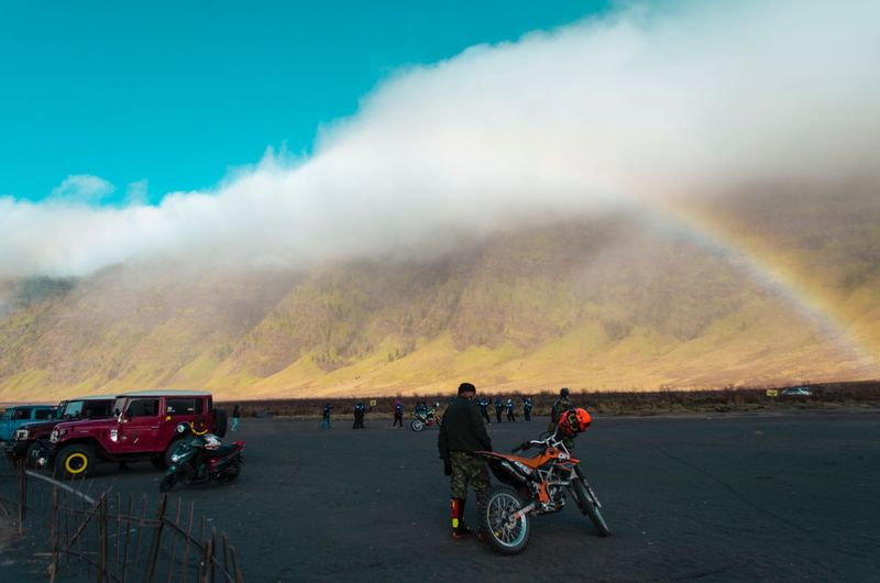 Rainbows at Teletubbies Hills,Bromo,Surabaya. Rainbow Teletubbies Hills EyeEm Selects Amazing Scenery Bromo Bromo-tengger-semeru National Park Transportation Mode Of Transportation Rainbow Land Vehicle Real People Group Of People Sky Beauty In Nature Mountain Scenics - Nature Nature Travel Lifestyles Day Leisure Activity People Men Motorcycle Cloud - Sky Road