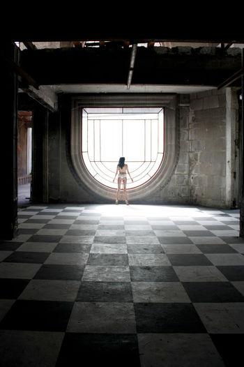 Woman In Lingerie In Empty Room
