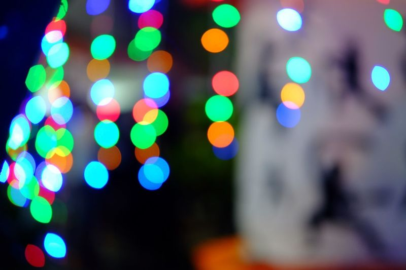 Illuminated Defocused Night Multi Colored Lighting Equipment City Decoration Holiday Street Light - Natural Phenomenon Architecture Shape Outdoors Geometric Shape Glowing Light Circle Close-up No People Focus On Foreground