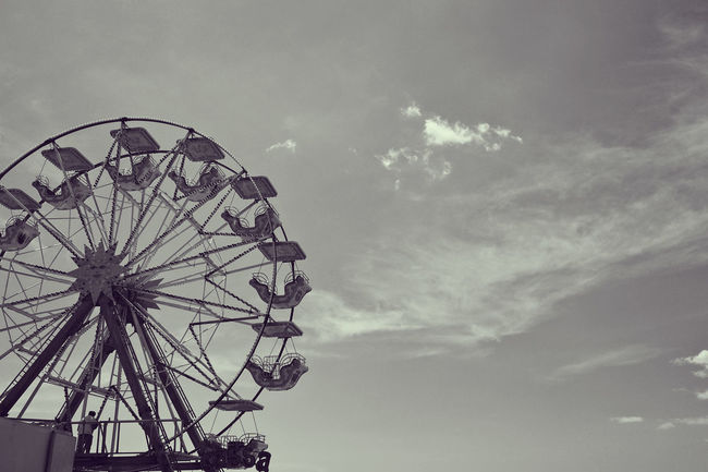 Ferris wheel at the seaside Carnival Festival Sky Cloud Beach Seaside Summer Holiday Fun Wheel Black And White Desaturated Ferris Wheel Amusement Park Ride Arts Culture And Entertainment Amusement Park Traveling Carnival Rollercoaster Tall - High Silhouette Spoke The Architect - 2018 EyeEm Awards The Great Outdoors - 2018 EyeEm Awards