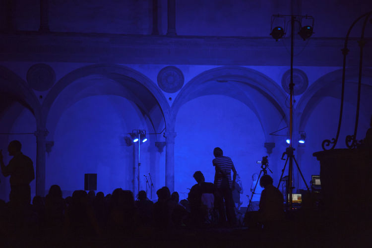 Florence, Santa Croce church and cloister. Adult Arch Architecture Building Built Structure Ceiling Crowd Group Of People Illuminated Indoors  Large Group Of People Leisure Activity Lifestyles Light Lighting Equipment Men Night Real People Silhouette Stage Standing Women
