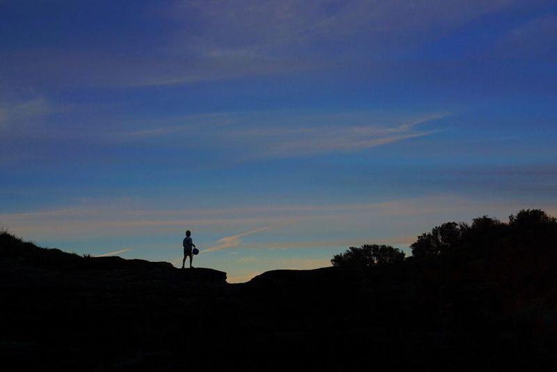 Breathing Space Silhouette Sky Nature One Person Real People Leisure Activity Beauty In Nature Outdoors Sunset Tranquil Scene Tranquility Standing Scenics Lifestyles Low Angle View Landscape Men Cloud - Sky Full Length Blue The Week On EyeEm