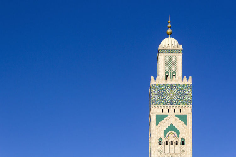 View of mosque against clear blue sky