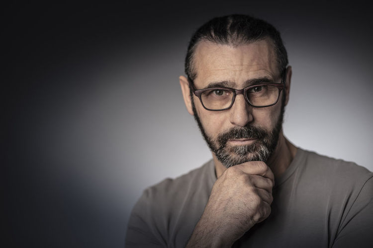 Long-hair Male Beard Portrait Adult Man Caucasian Face person Hair Hairstyle Fashion Modern Handsome Model Lifestyle Expression Urban Lumberjack Hair Look Barber Casual Man Fashionable Man Beardoholic Trendy Man Hipster Masculine European  Thinker Thinking Think Standing Glasses