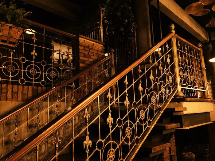 Stairs Architecture Built Structure Railing No People Night Indoors  Pattern Staircase Illuminated Metal Steps And Staircases Creativity Low Angle View