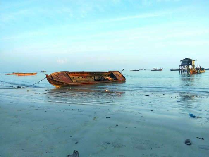 Sea Nautical Vessel Transportation Beach Outdoors Nature Water Tranquility No People Day Sky Beauty In Nature Sunken UnderSea Tradisional Fish Chatcher Fisherman Only Men Fishermen Beach View Beach Life Sea Life Fishing Equipment Leisure Activity Full Length Horizon Over Water