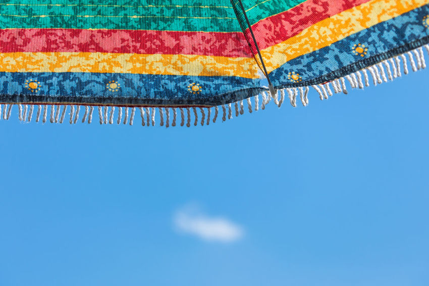 Clear Sky Cloud Hot Summertime Weather Blue Clear Sky Close-up Copy Space Day Focus On Foreground Little Cloud Low Angle View Multi Colored Nature Nice Weather No People Outdoors Parasol Pool Protection Shadow Sky Striped Summer Sunlight Sunshade Swimming Pool Textile Warm Water
