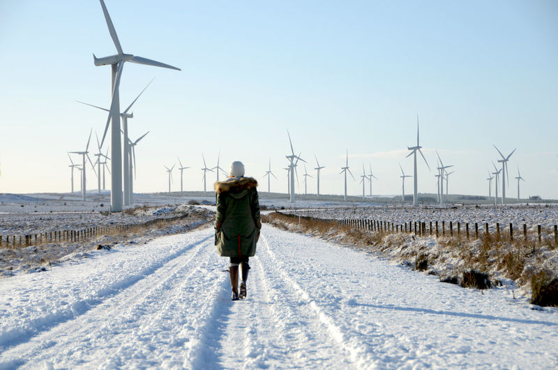 Alternative Energy Diminishing Perspective Full Length Horizon Over Land Landscape Remote Road Rural Scene Snow Snowing The Great Outdoors - 2016 EyeEm Awards The Way Forward Tranquil Scene Tranquility Vanishing Point Walking Windfarm Windfarms Windmill Windmills Windturbine Windturbines Market Reviewers' Top Picks