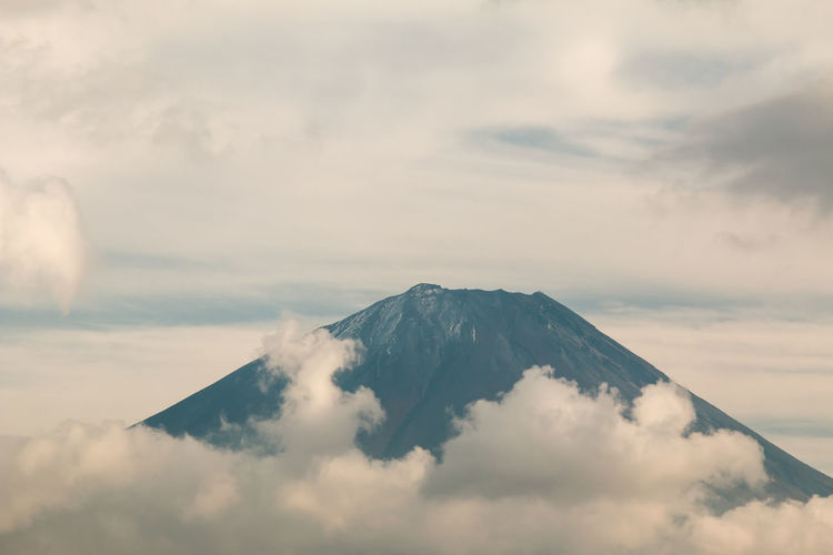 Close up of mouth crater of fuji san with many cloud around in autumn season of japan