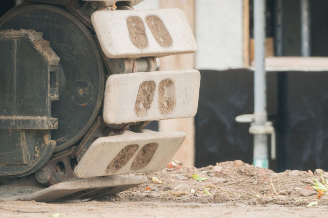 Front wheel of an excavator on the construction site Construction Construction Site Construction Machinery Industrial Industry Worker Close-up Construction Work Day Hydraulic No People Outdoors Powerful Tyres
