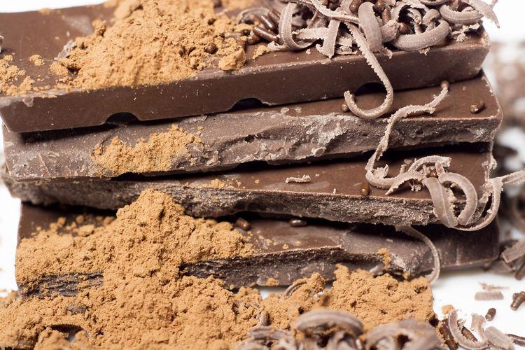 Close-up of chocolate bars and powder