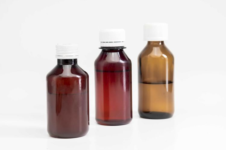 Bottle of medicine Studio Shot Bottle White Background Container Indoors  Healthcare And Medicine No People Medicine Group Of Objects Red Close-up Glass - Material Copy Space Still Life Science Food And Drink White Color Plastic Wellbeing Temptation Blank