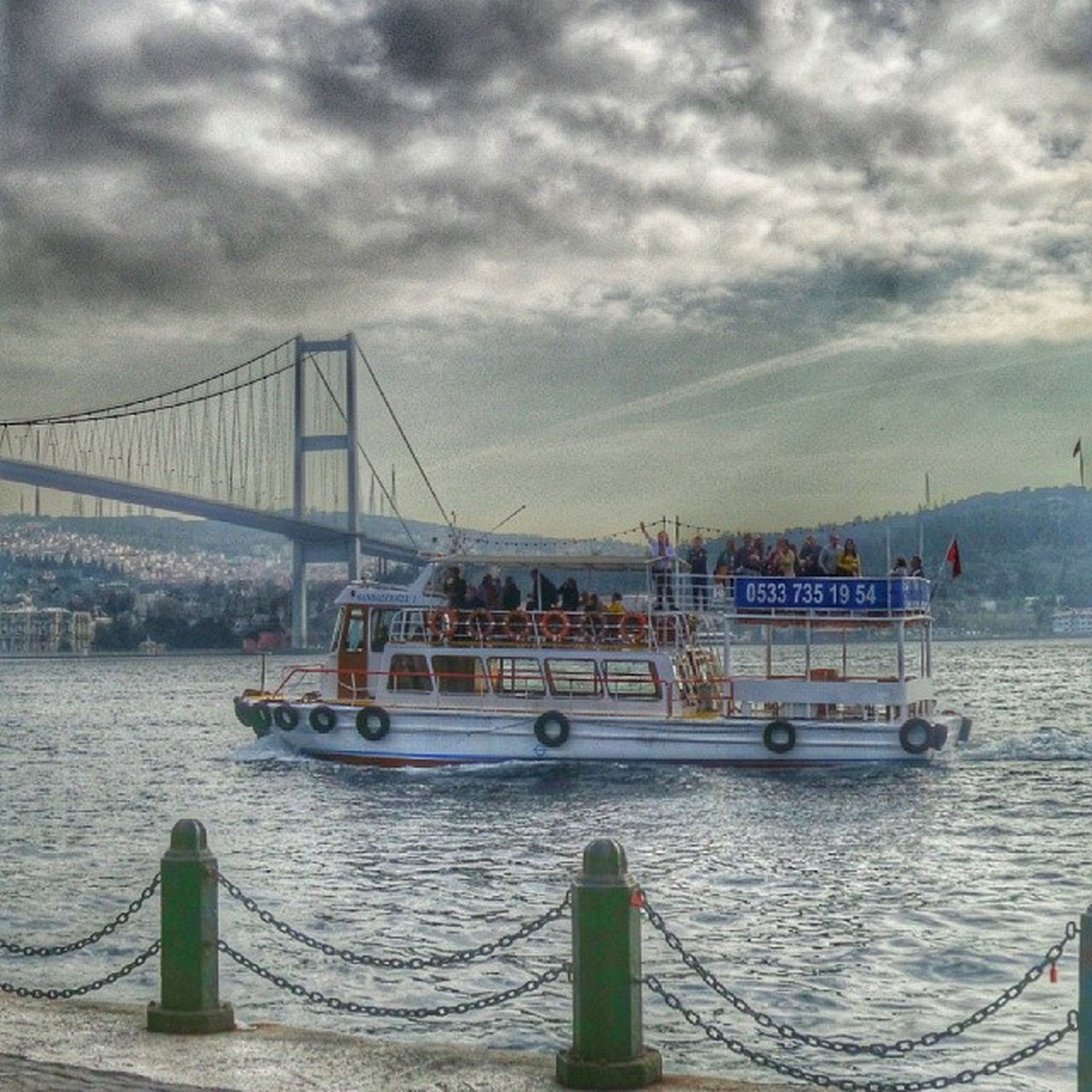 nautical vessel, transportation, sky, water, mode of transport, sea, cloud - sky, boat, cloudy, moored, cloud, harbor, nature, pier, waterfront, travel, outdoors, mast, overcast, built structure