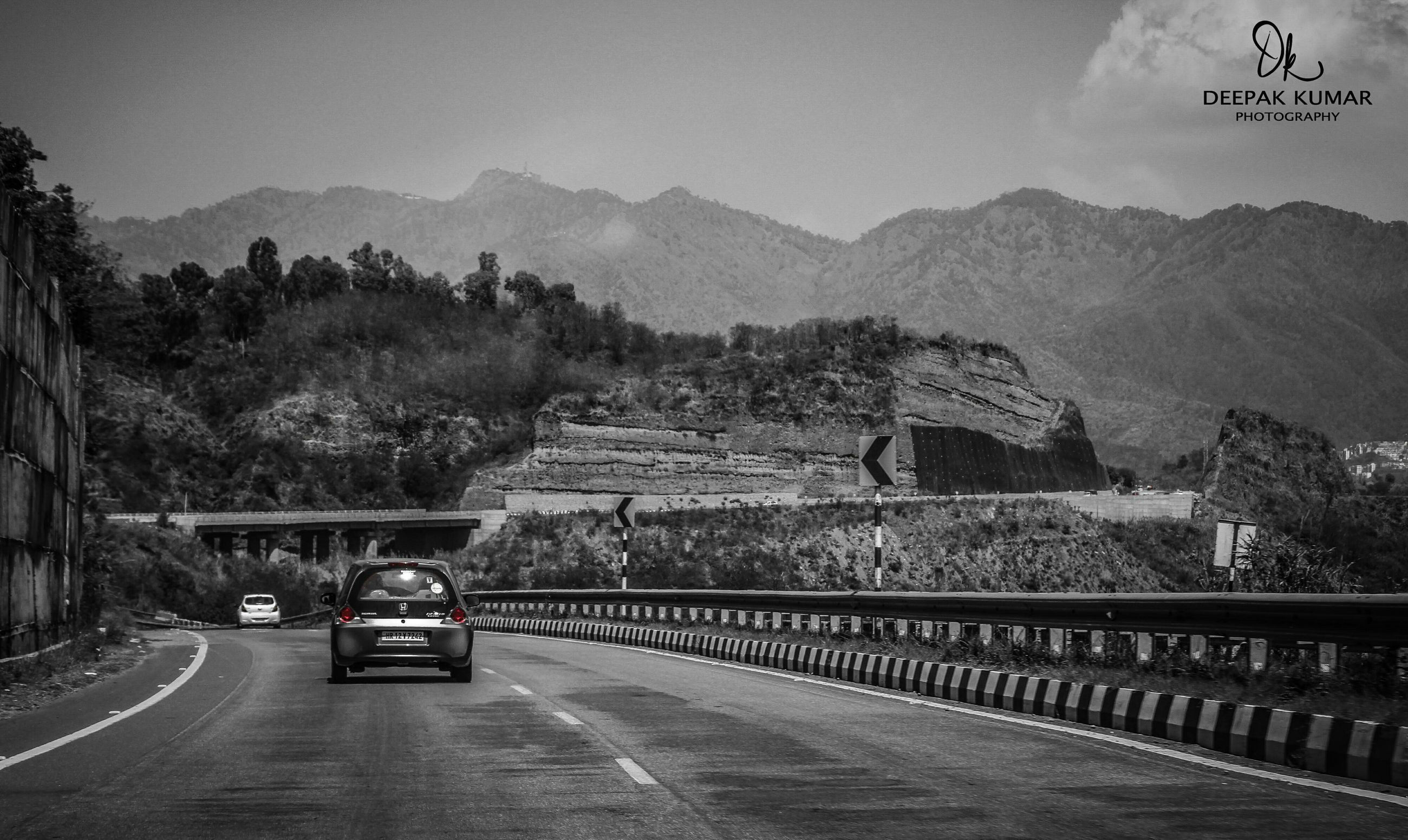 transportation, road, mountain, the way forward, car, road marking, land vehicle, mode of transport, street, mountain range, sky, diminishing perspective, clear sky, vanishing point, tree, built structure, country road, architecture, outdoors, highway