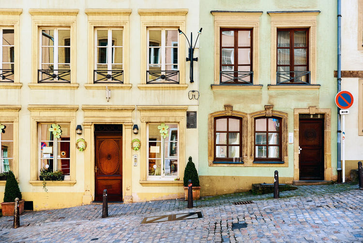 Hillside house in the old town of Luxembourg. Western Europe Alleyway Architecture Building Exterior City Cobblestone Streets Day Facade Building Hillside Luxembourg No People Nobody Old Town Outdoors Sidewalk Spring Street Sunny Sunny Day Typical Houses Urban Western Europe Window