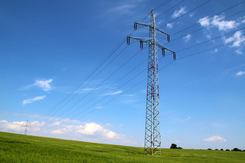 Sky Technology Electricity  Electricity Pylon Cable Field Connection Power Supply Land Power Line  Nature Fuel And Power Generation Low Angle View Landscape Grass Plant Cloud - Sky Environment No People Rural Scene Outdoors Electrical Equipment Complexity Energy Pylon