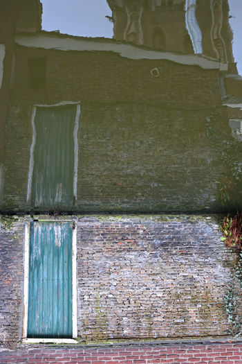 Architecture Bricks Building Exterior Built Structure Close-up Day Door No People Outdoors Reflection Upside Down Water