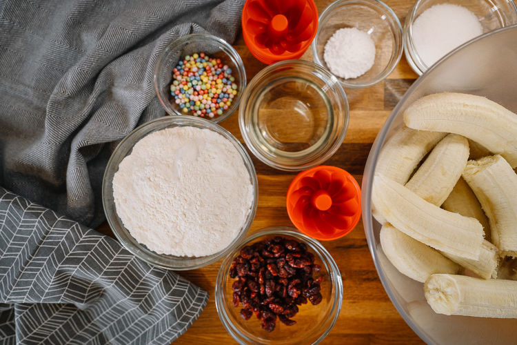 High angle view of banana bread ingredients in bowls on counter in the kitchen