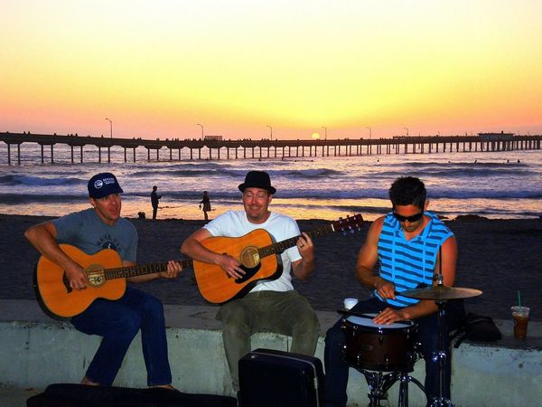 Hanging Out Silhouettes Young And Beautiful Beach Fun Casual Clothing Lifestyles Real People Young Adult Young Beach Crowd Young Musicians