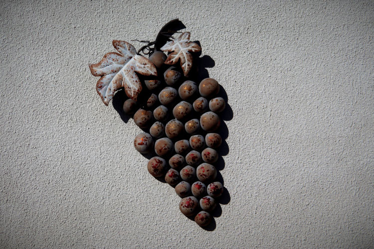 High angle view of pine cone on table
