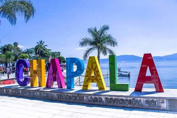 Chapala Palm Tree Outdoors Multi Colored No People Sky Water City Mexico Jalisco Chapala Mi Tierra Travel Destinations Chapala Lake