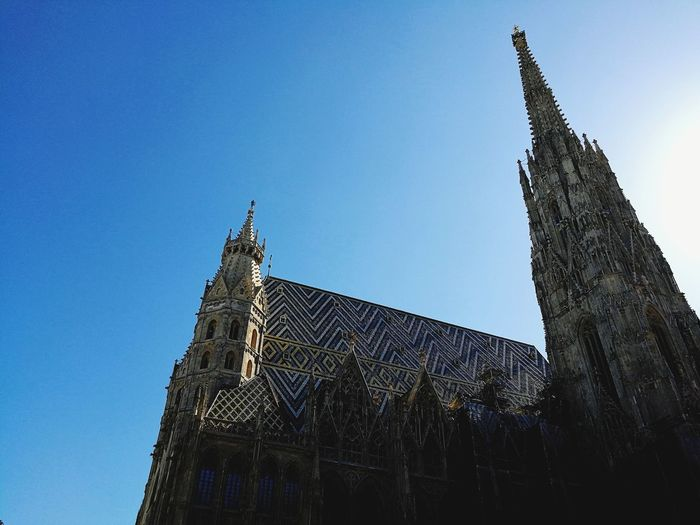 Stephandom, Vienna, Austria. Architecture Low Angle View Religion Built Structure Building Exterior Tower Place Of Worship Clock Tower Clear Sky No People Outdoors Wanderlust Austria Vienna Travel Photography Spirituality Architecture Travel Destinations History Day Modern Sky Clock Clock Face