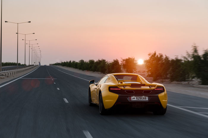 570S Diminishing Perspective Journey McLaren Middle East Money Nature No People Outdoors Rich Road Sky Supercar The Way Forward Vanishing Point Yellow Need For Speed