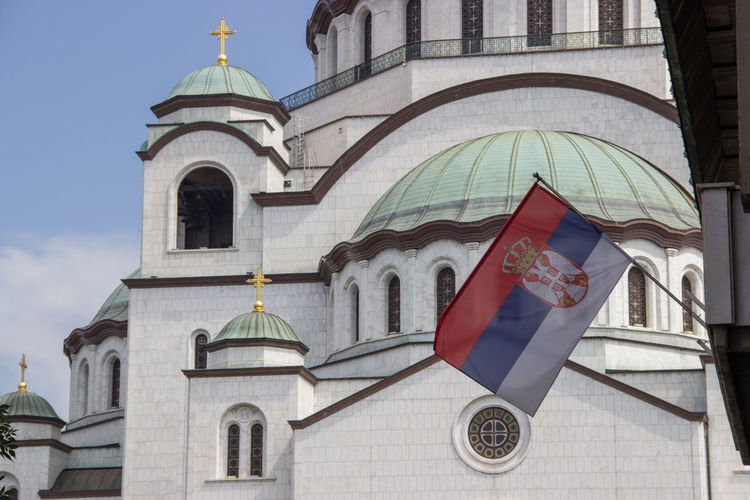 Cathedral Church Cross Roof Serbia Travel Architecture Bell Tower Building Exterior Built Structure Churches Cross Day Dome Flag Flags In The Wind  Low Angle View No People Outdoors Place Of Worship Religion Sky Spirituality Symbol Travel Destinations