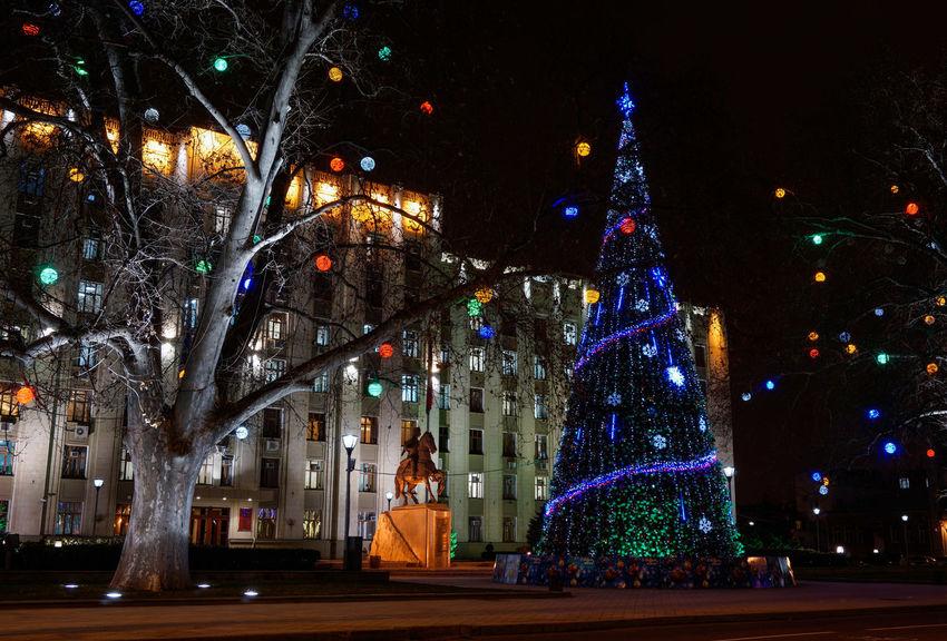 Cities At Night Welcome To Black Illuminated Christmas christmas tree Night Celebration Tree Christmas Lights Christmas Decoration Outdoors Building Exterior Architecture City