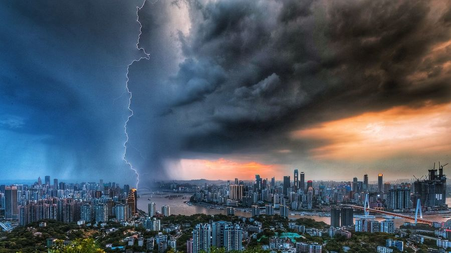 Panoramic view of city against dramatic sky